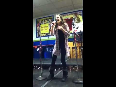 Amazing girl singing at karaoke night