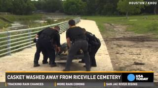 Texas floodwaters raise casket from grave