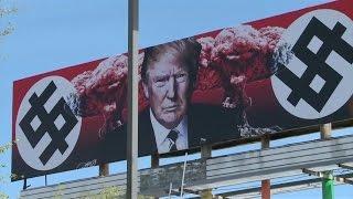 Kunstaktion: Trump mit Atompilzen und Pseudo-Hakenkreuzen
