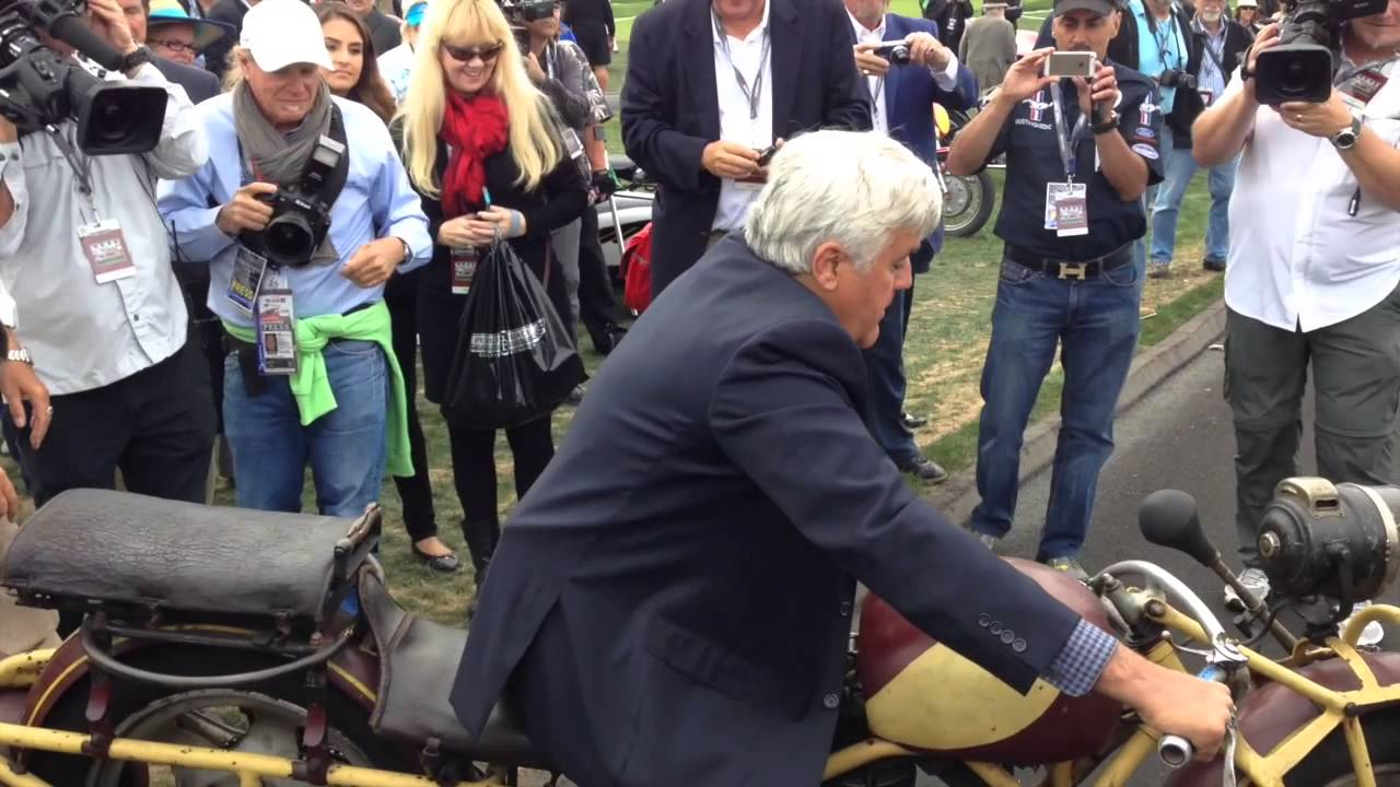 Jay Leno Riding A Motorcycle In The Pebble Beach Concours