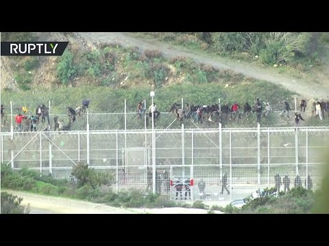 'Extremely violent, organized:' 1,000 migrants storm Spanish enclave bordering Morocco (VIDEO)