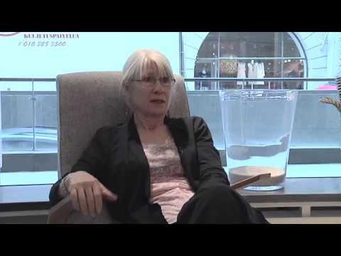 """Susan Saarinen on """"Grasshopper"""" chair by Eero Saarinen"""