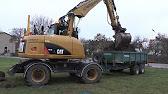 56f0d947910 Escavadeira de rodas Cat M313D - YouTube