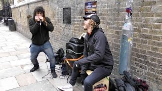 London Street Music. Harmonica Player and Drummer Performing in Brick Lane