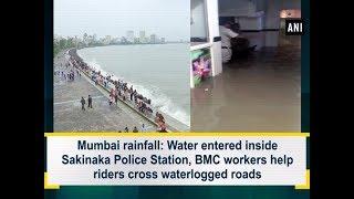Mumbai rainfall Water inside Sakinaka Police BMC workers help riders cross waterlogged roads