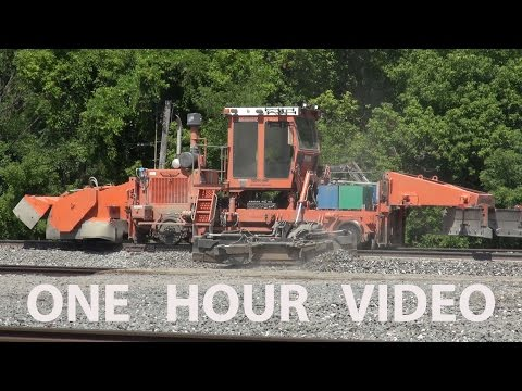 Heavy Equipment Railroad Track Maintenance with trains passing work zone - Berea, Ohio