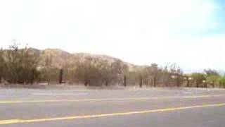Driving through Yucca Valley listening to America
