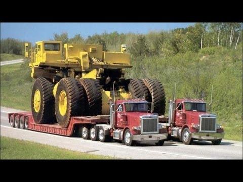 Мощные грузовые автомобили перевозят огромные грузы 2017