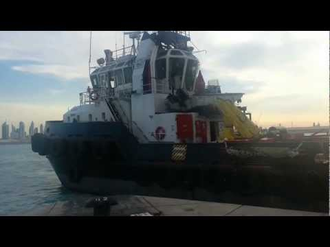 Supply Boat Berthing in Port Rashid with Beautiful Dubai in the Background.mp4