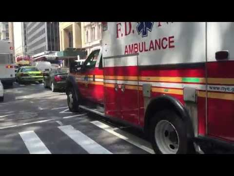 FDNY EMS AMBULANCE RESPONDING ON BROADWAY IN THE FINANCIAL DISTRICT OF MANHATTAN IN NEW YORK CITY.