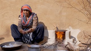 Indian housewife preparing roti /chapati for the family in Indian village
