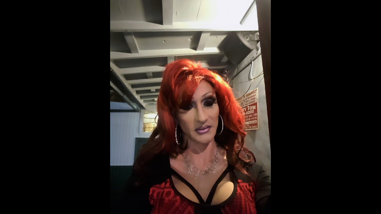 drag queen red hair and outfit