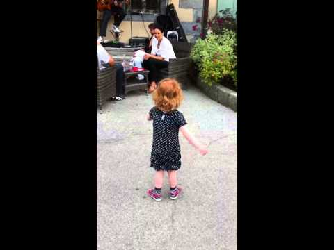 Cecilia dancing to live music in Chamonix