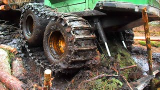 John Deere 1110D in mud, difficult conditions