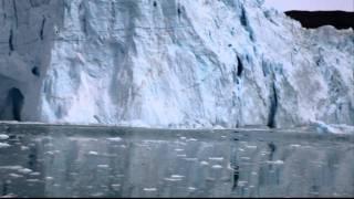ice calving at eqi glacier greenland