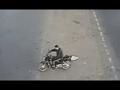 WATCH Heart stopping moment motorcyclist narrowly escapes d eath