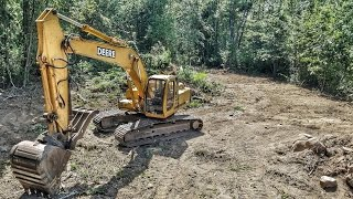 John Deere 200lc Excavator Clearing Trees - Drone View