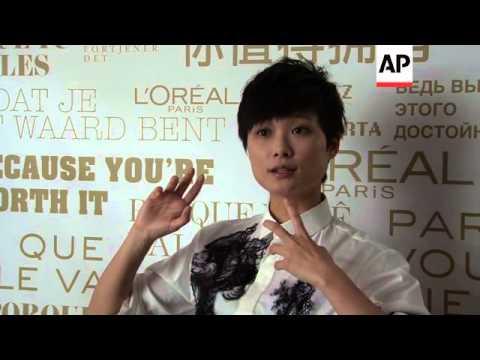 Singer and L'Oreal ambassador Li Yu Chun chats to press at the Cannes film festival