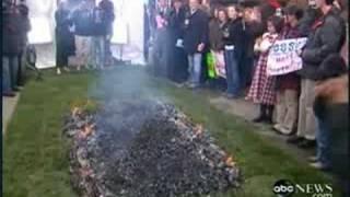 Diane Sawyer walks on hot coals