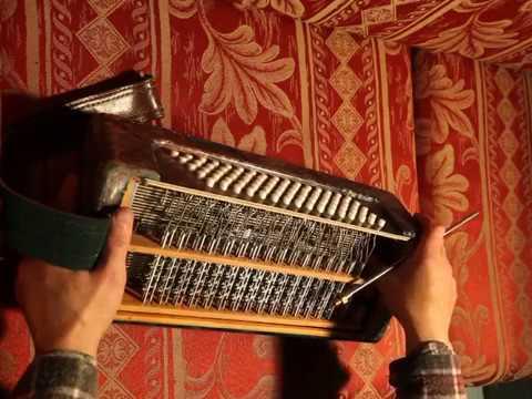 Гармонь, баян, аккордеон. Механика левой на валиках.