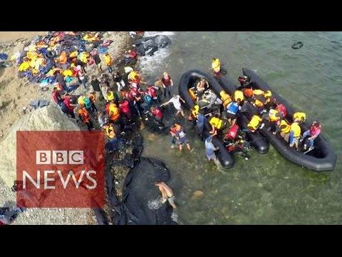 Drone video shows migrants' arrival - BBC News