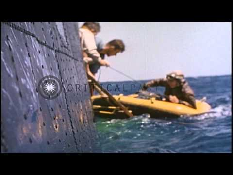 A pilot comes aboard PBM Mariner during air sea rescue work in the Pacific Ocean ...HD Stock Footage