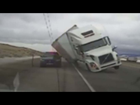 Caught on camera: Truck blows over in wind storm