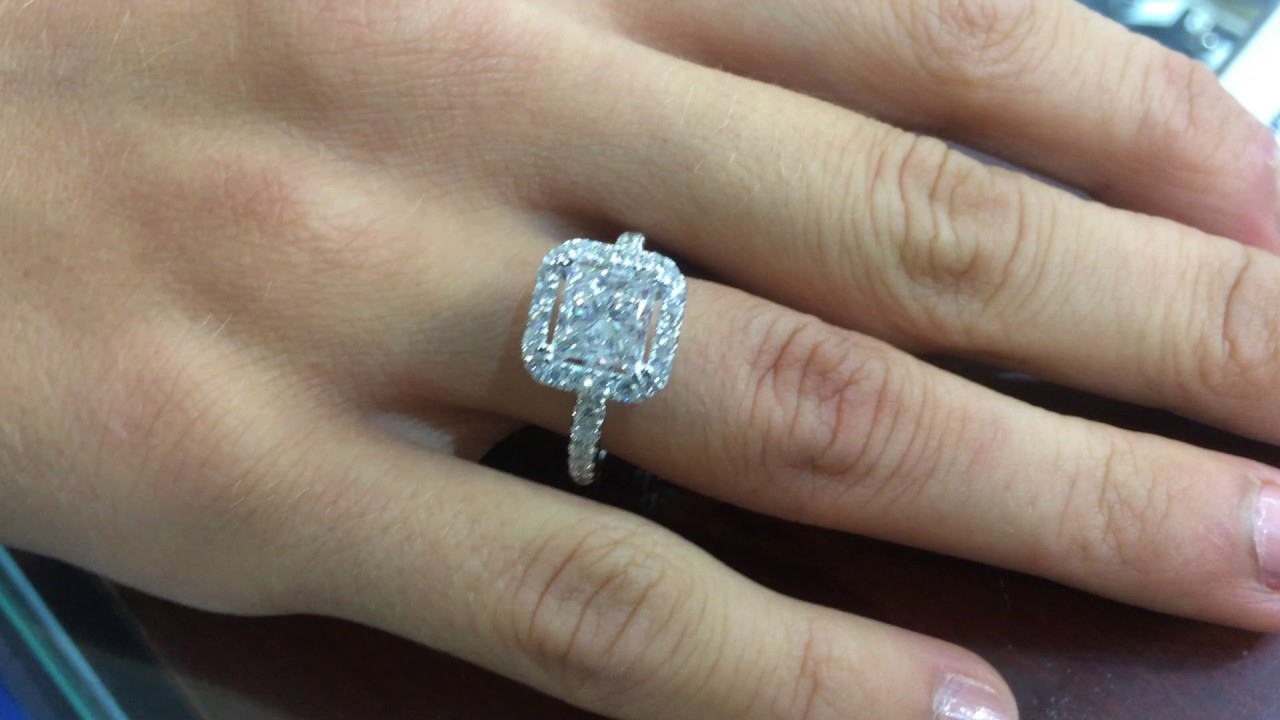 Small Princess Cut In A Cushion Halo With One Row Micro Pave