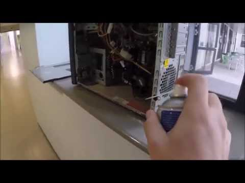 Using compressed air to clean a PC