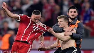 Bayern Munich charged by UEFA over pitch invasion and offensive banner following loss to Real