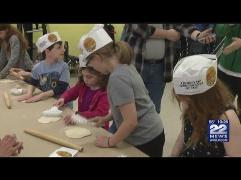 Children learn how to make matzah at Lubavitcher Yeshiva Academy ahead of Passover