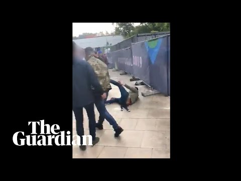 Tommy Robinson filmed punching man outside England match