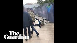 Tommy Robinson filmed punching man outside England match in Portugal
