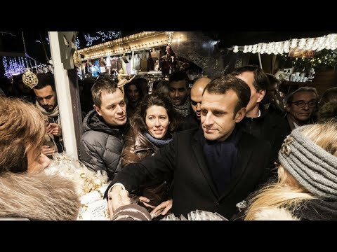 Macron visits Strasbourg as Christmas market reopens after shooting