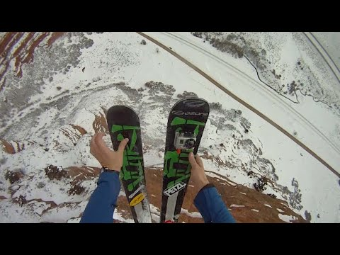 Daredevil Skiing Into A Parachute Free Fall
