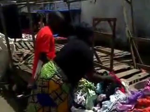 A first time entrepreneur setting up her business of selling used clothing in Lusaka, Zambia