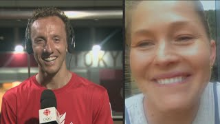 Cyclist Michael Woods surprised by wife Elly on TV after race
