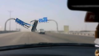 Truck's Trailer Crashes Into Highway Sign