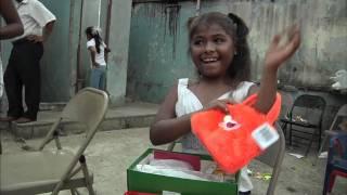 Happy Girl Opens Her Shoe Box - Operation Christmas Child - Samaritan's Purse