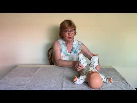Instructievideo bij een baby met de neiging tot veel strekken en een afplatting middenachter IMG9221