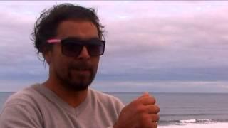 Tom Avery flies the Aboriginal Flag surfing at Bells Beach