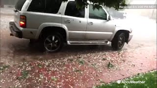Storm chaser Reed Timmer is pelted with hail in Colorado
