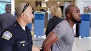 Flying into usa LAX airport police arrest a man with a  Felony  Warrant