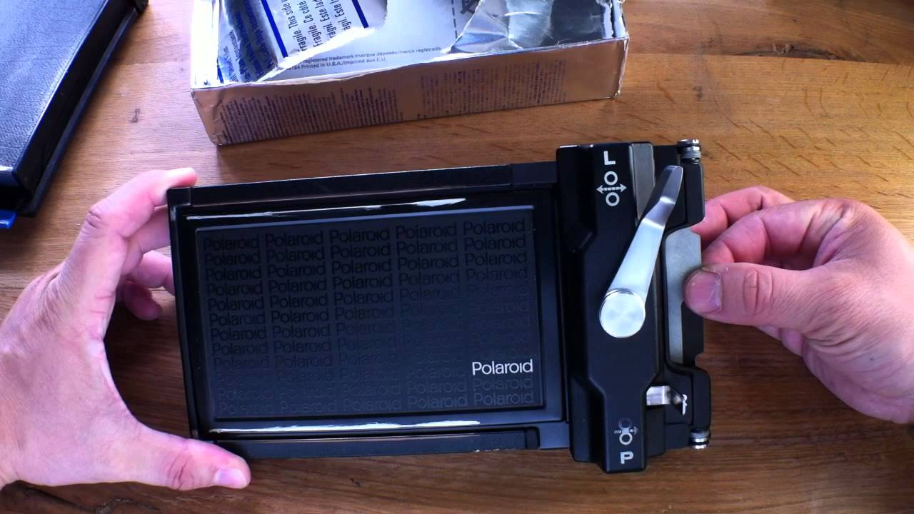 Loading a Polaroid 545 Largeformat Back with 4x5 Sheet Film (german ...