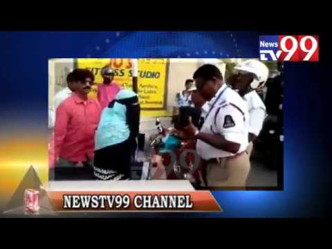 ANGRY WOMEN FIGHT WITH TRAFFIC POLICE IN HYDERABAD