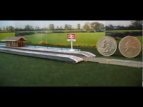 9 Coach T gauge Intercity 125 runs through BR Pangbourne - Coins for scale