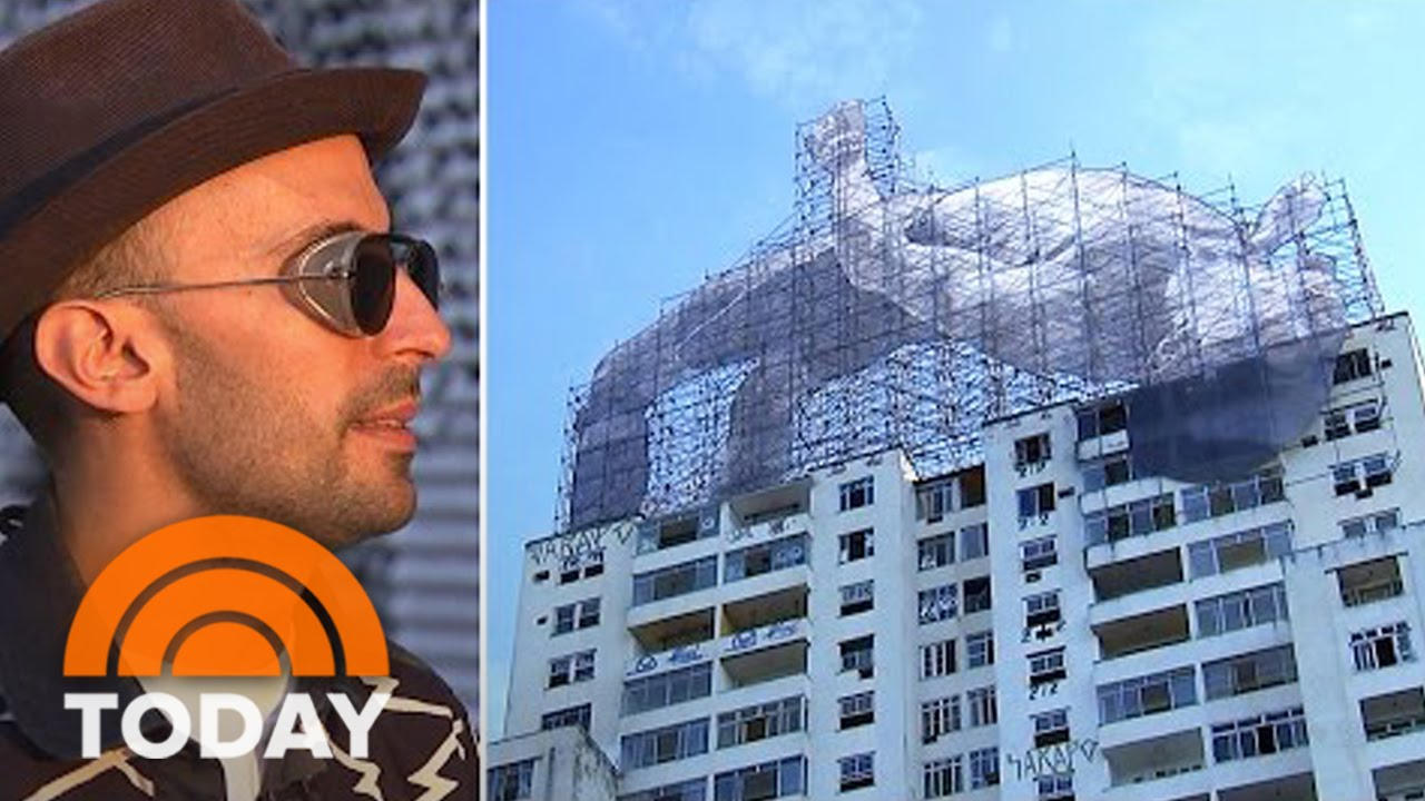 Meet 'JR,' The 'Semi-Anonymous' Street Artist Behind Rio's Massive Art Project   TODAY