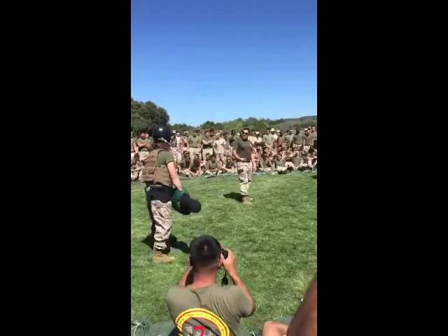 Female Marine Vs Male Marine in a round of pugile sticks.