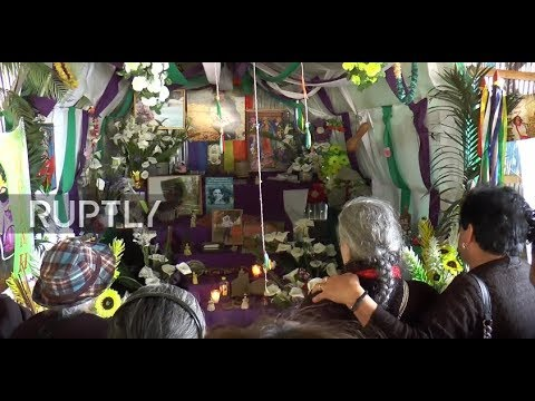 Honduras: Mother of slain indigenous activist tears up at commemorative altar