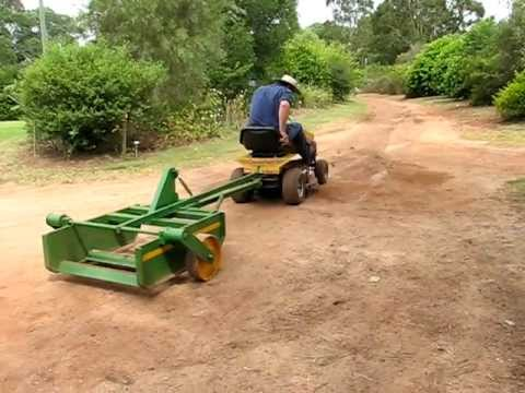 Road grader with ride on mower - YouTube